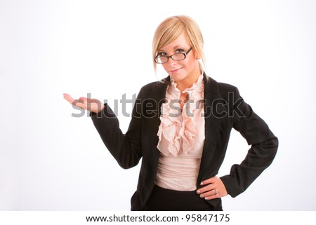 blonde businesswoman in business attire holding out her hand as if presenting something - stock photo
