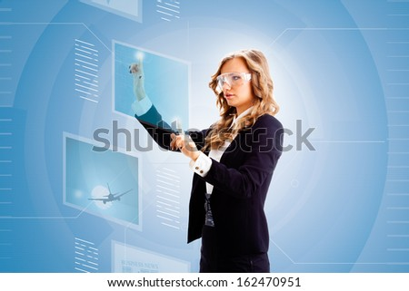 blonde businesswoman in future working virtual interface - stock photo