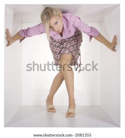 blonde businesswoman in the white cube - stock photo