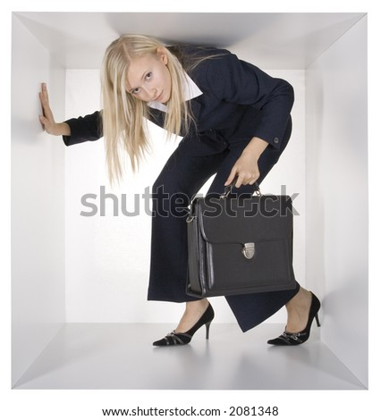 blonde businesswoman with black suitcase in the white cube - stock photo