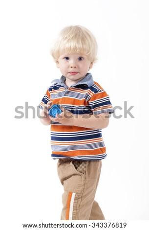 Blonde caucasian child playing educational toys isolated on white background. - stock photo