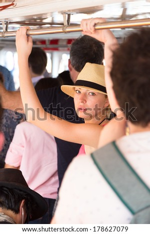 Blonde caucasian lady traveling by public transport. - stock photo