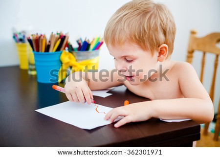 Blonde child painting with pen - stock photo