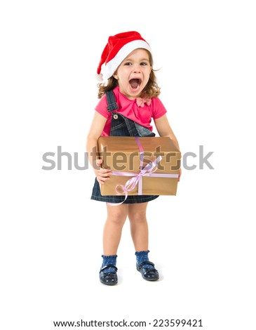 Blonde christmas kid with a gift doing surprise gesture