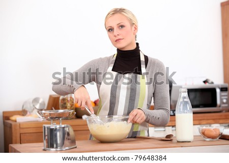 blonde cooking at home - stock photo