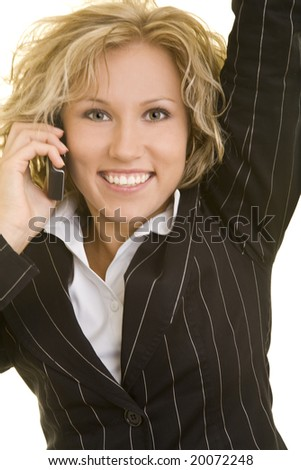 Blonde corporate woman using her cell phone - stock photo