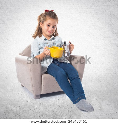 Blonde cute girl holding a cup of tea - stock photo