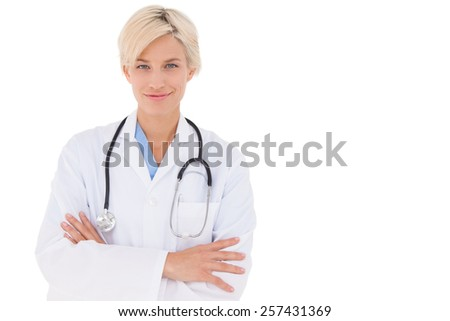 Blonde doctor smiling at camera on white background - stock photo
