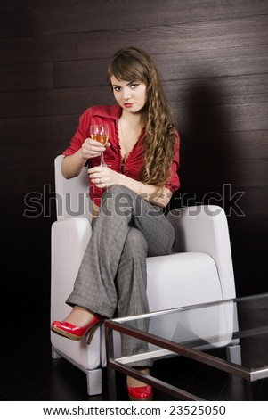 Blonde dressed up in red holding a wineglass