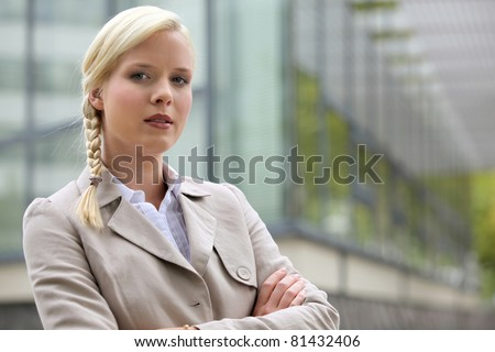 Blonde executive standing outside - stock photo