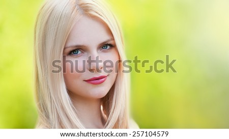 blonde face beautiful romantic elegant woman with blue eyes in nature spring background 8 March, nature romantic wellness pure makeup, professional cosmetics spa - stock photo