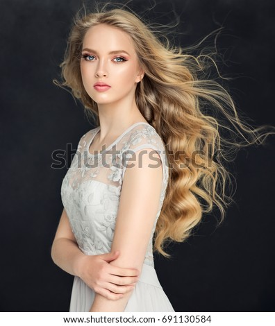 blonde fashion girl long shiny curly stock photo royalty