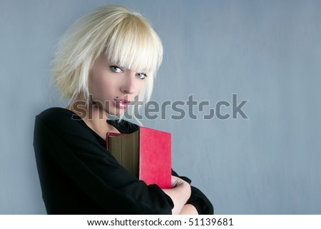 blonde fashion student holding red book - stock photo