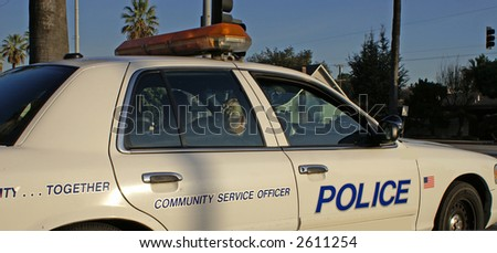 Blonde Female Police officer in cop car - stock photo