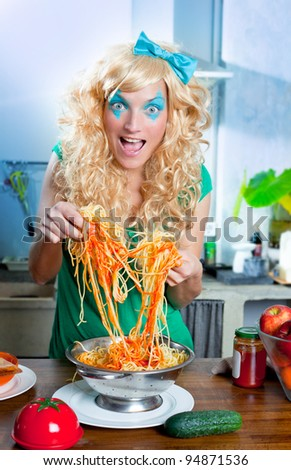 Blonde funny on kitchen with pasta and fashion blue makeup - stock photo