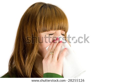 Blonde girl blowing nose, isolated on white background