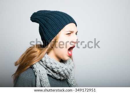 blonde girl celebrates victory, Christmas and New Year concept, studio photo isolated on a gray background