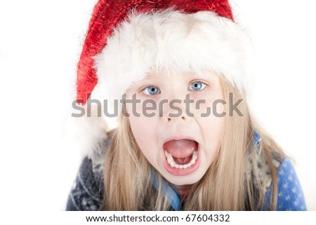 Blonde girl crying in a sweater and a Christmas hat - stock photo