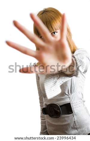 Blonde girl hiding behind her palm, isolated on white background