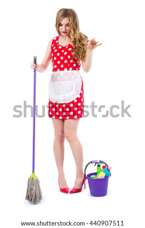 Blonde girl in a red dress housewife with curlers in the house cleaning. Housekeeper with cleaning tools: a bucket, a mop, detergents, isolated on white background.