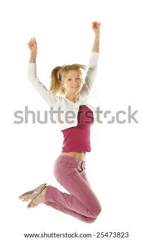 Blonde girl in pink jeans jumping over white background