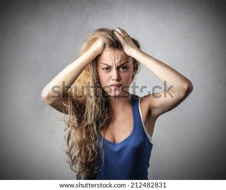 blonde girl looking disappointed - stock photo