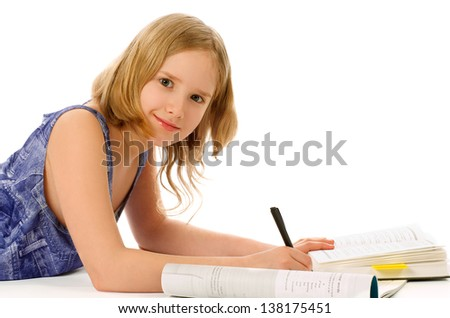 Blonde Girl Lying Down and Studying with Books, Exercise Book and Pen on white background