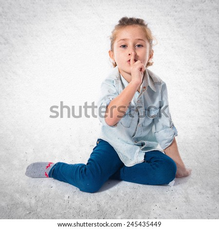 Blonde girl making silence gesture over white background - stock photo