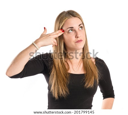 Blonde girl making suicide gesture over white background