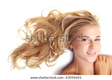 Blonde girl model with long hair in studio beauty shot