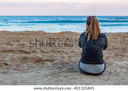 Blonde girl near the ocean - stock photo