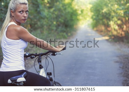 Blonde girl on Bicycle