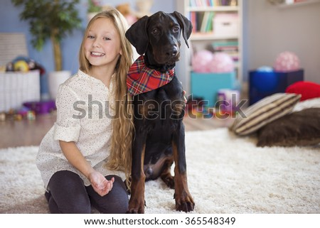 Blonde girl posing with her charming dog - stock photo