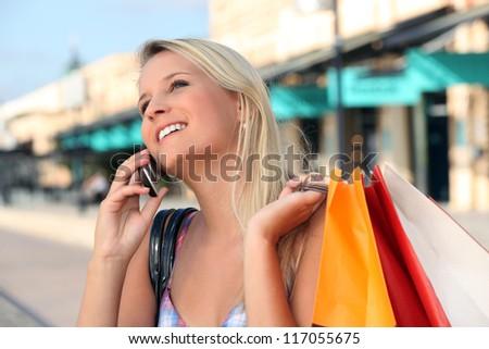 Blonde girl shopping - stock photo