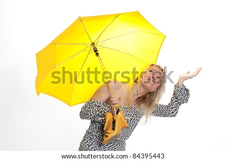 Blonde girl standing under umbrella feel if it is raining isolated on white - stock photo