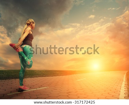 Blonde girl started running  - stock photo