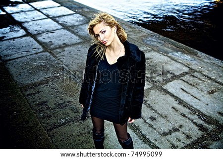 Blonde girl street fashion portrait. - stock photo