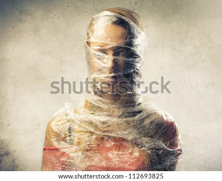 Blonde girl trapped in the plastic - stock photo