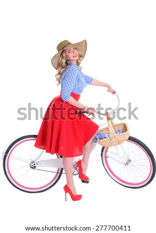 blonde girl with a bicycle in a retro style on a white background - stock photo