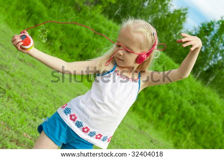 Blonde girl with closed eyes red earphones is listening mp3 player music and dancing