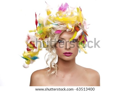blonde girl with feathers - stock photo