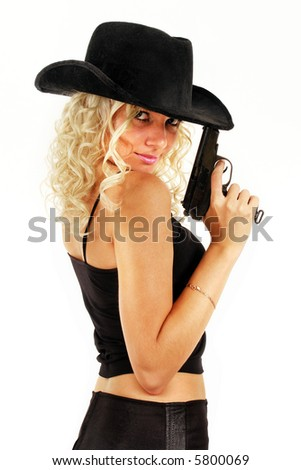 Blonde girl with gun. Isolated on white.