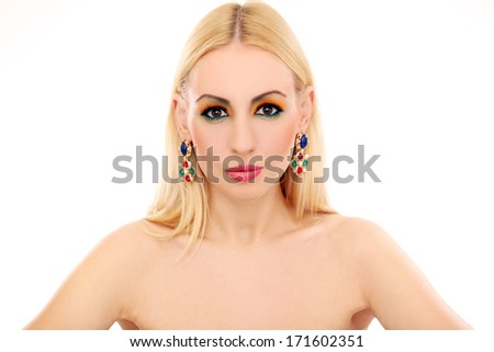 Blonde girl with jewelry has colored makeup - stock photo