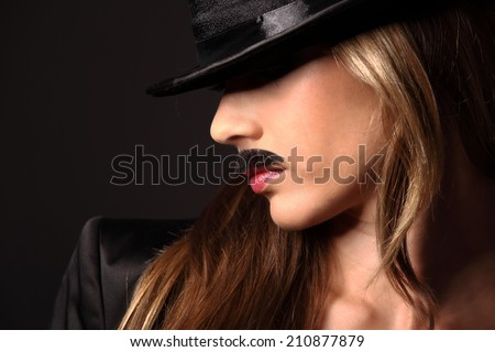 Blonde girl with mustache looking at camera, look like a man