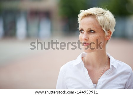 Blonde girl with short hair and freckles - stock photo