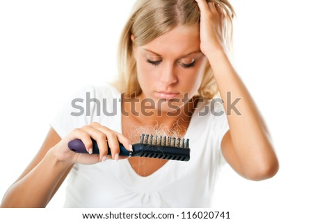 Blonde girl worried about hair loss,Hair loss - stock photo