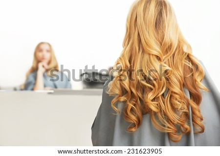 Blonde Hair. Woman in hair salon - stock photo
