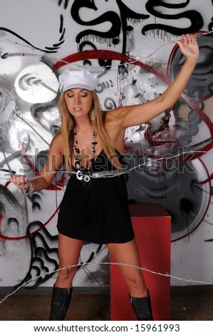 Blonde haired beauty in a black dress and white cap