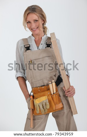 blonde handywoman holding boards - stock photo