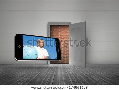 Blonde happy boy on smartphone screen against open door with wall behind it